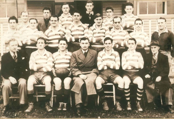 DOWTY RFC 1ST XV - 1955-56 Rear – C.Raven, (Unknown), R.Hughes, G.Picard, F.Lomax, H.Major Middle – R.James, S.Clements, E.Gater, G.Llyod, D.H.G.Lewis, E.J.Smith, (Referee) Front – T.Lockhart (Trainer), K.Billing, J.A.G.Beard (Captain), W.Petts (Chairman), K.Browning, R.Davies, S.James (Committee) | Dowty RFC