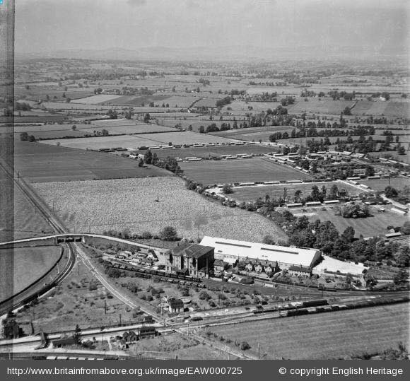Ashchurch 7 May 1946. This super aerial view shows the tall provender store and the sidings, with the brand new Dowty factory behind