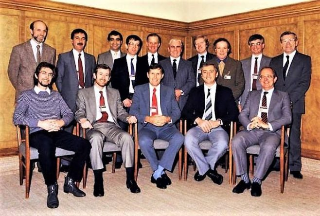 Dowty Fuel Systems 1989 A meeting to celebrate the 25 year service to the company of David Foster who kindly gave permission to use his photo. L-R right back row 1 to 10. Seated 11 to 15. 3. Tony Belisario. 4 David Foster. 5 Geoff Smith. 6. Pat Martin. 8 Frank Hopkins. 10 Albert Hall 11 Ernie Wathan? 12 Tim Davies. 13 Brian ?? 15 Brian Poolman