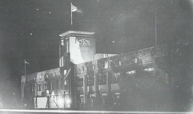 Photo showing Rotol building at the end of WW2 with camouflage paint and flags flying for VE
