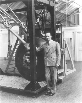 Photo of Sir George Dowty - standing next to Avro Lancaster Dowty Undercarriage