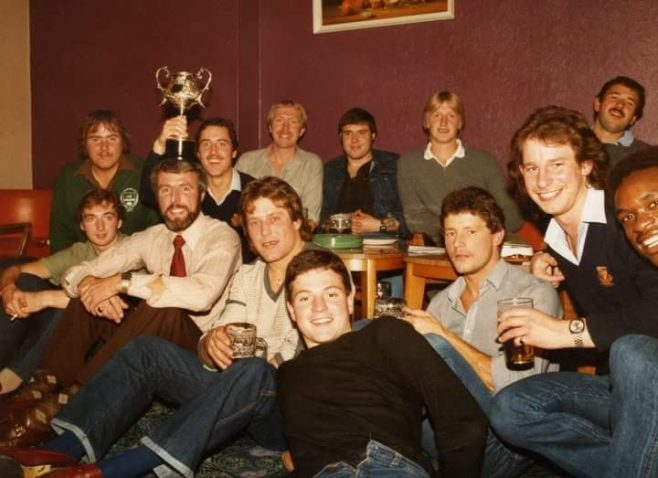 Dowty Rotol Inter departmental Rugby union winners 1981 Experimental ~ Ade Stephenson with cup, John Clay with cup on his head, John Evans, Gary Payne, Mark Teague, Steve Dunn, Kev Noonan, Mark Owen, Sean Nealy, Stu Dix, Paul Kennett, Errol Westcarr