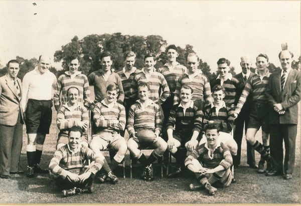 DOWTY RFC 1ST XV – 1956-57 Rear – W.Burford (Committee), (Referee), M.Canning, K.Browning, G.Picard, J.Brown, G.Llyod, J.Wood, F.Lomax, (St John's Ambulance Officer), R.Davies, P.Matthews Middle – B.Payne, D.H.G.Lewis, K.Billing (Captain), E.Gater, M.Crouch Front – E.J.Smith, R.Morgan | Dowty RFC