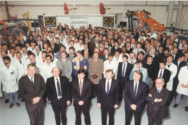 First set of A330/340 gears delivered. Tony Thatcher on the left, then Jim Lightfoot, then Chris Geoghan, then Graham Lockyer, then another gentleman from Airbus (?) and finally Mike Spence on the front right.   John Herring