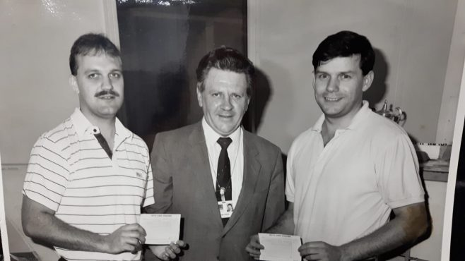 L-R: Nick Fowke; Brian Dawes; Kevin Boote 1985 Receiving a cheque from Brian Dawes, Dowty Rotol Gear Shop Manager as part of the Suggestions Scheme . | Kevin Boote