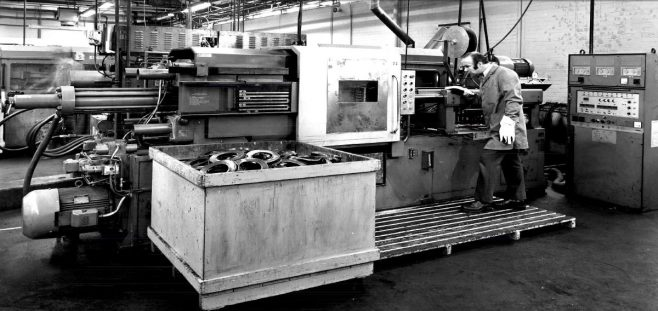 Graham Keightley, running an injection moulding press. c.1970 | Richard Keightley