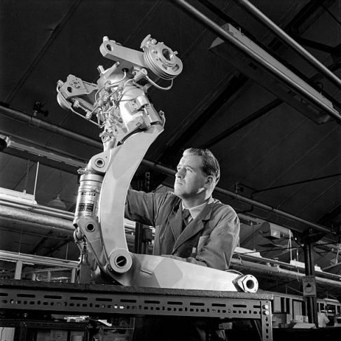 Dowty Engineer examines a hydraulic brace for a jet aircraft wheel assembly