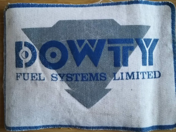 Dowty Fuel Systems - logo worn on overalls