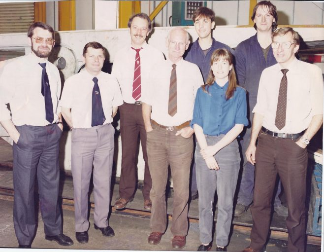 Members of the Test House team early 1990s Stood in front of a Advancing Ram Function Test Rig. Front Row L-R: David Marjoram (Manager at this time); Mike Buckle; Denzil Gullick; Julia Payne; ? John Woodbridge: Back Row L-R: Jaz Boulton; Paul Dell; David Haynes  | Mike Buckle