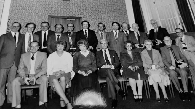 Long Service Awards: Front Row L-R: Geoff Strain; Val Pollard; ?; Peter Wall MD; Eileen? (worked in Stalag), ?; ?; Dennis Neal. Back Row L-R: ?; ?; Mike Chance; Mike Stephenson; ?; ?; Geoff Musto; ?; ?; Ted Murden; ?; Dick Gaine. | Gary Musto