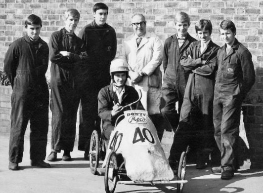 Dowty Meco pedal car made by first year apprentices. Raced at Bristol Airfield for 24 hours. Many years of service from this group of workers. Dave Bright, Stephen Bradley, Geoff Bishop, Charlie LaCroix, David Bradley, John Love, Geoff Twinberrow. In car, Roger Bradley. | David Bradley
