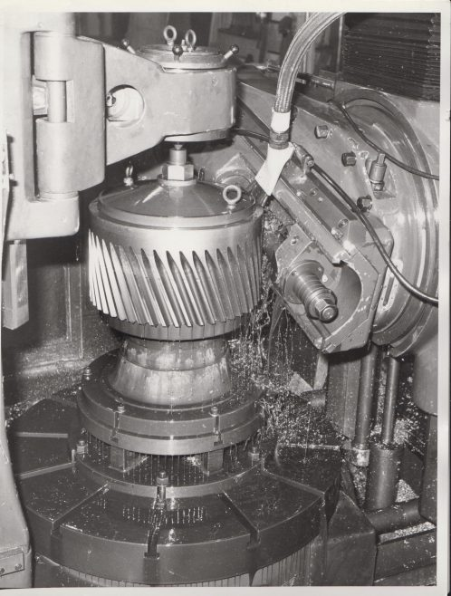 Close up of Hobbing Machine cutting gears in the machine shop | Original photo in the Dowty archive at the Gloucestershire Heritage Hub