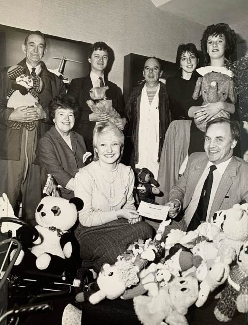 Doreen Hunter in the middle and Kath Lynch behind her. Behind Kath is Geoff Strain a Union Rep. They collected for charity at Christmas and this was probably what it was handing over toys and cash for Christmas presents.