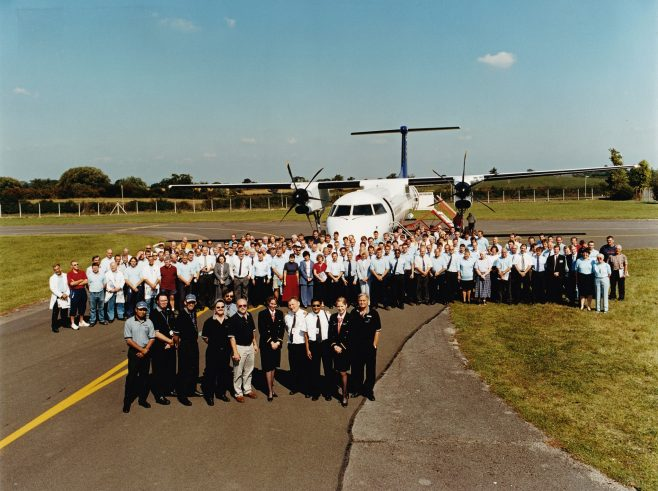 Bombardier Dash 8-Q400 at the end of runway 18, Gloucestershire Airport, with the assembled workforce of Dowty Propellers, late 1999 | Steve Barrett