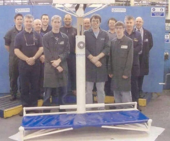 Second year machining apprentices posing with the restored pool hoist in 2006 | Darren Devaney